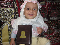 Muslim-Baby-Girl-with-Holy-Quran.jpg
